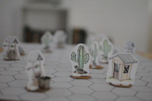 Cactus and other props assembled and positioned on the hexagonal game board